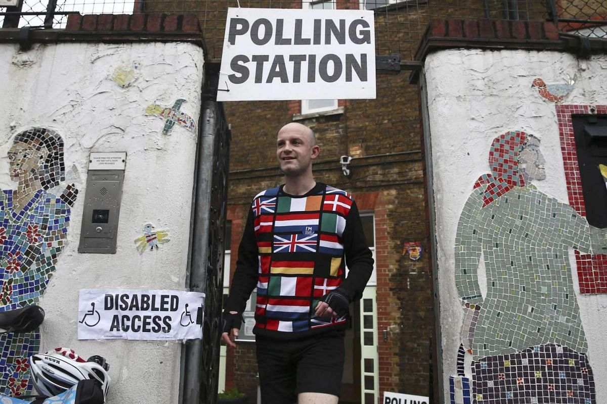 A man wearing a European-themed cycling jersey leaves after voting at a polling station in north London on June 23, 2016.