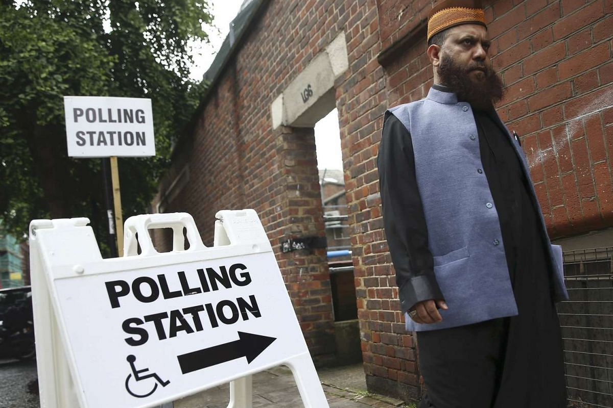 A man leaves after voting at a polling station in Tower Hamlets, east London, on June 23, 2016.