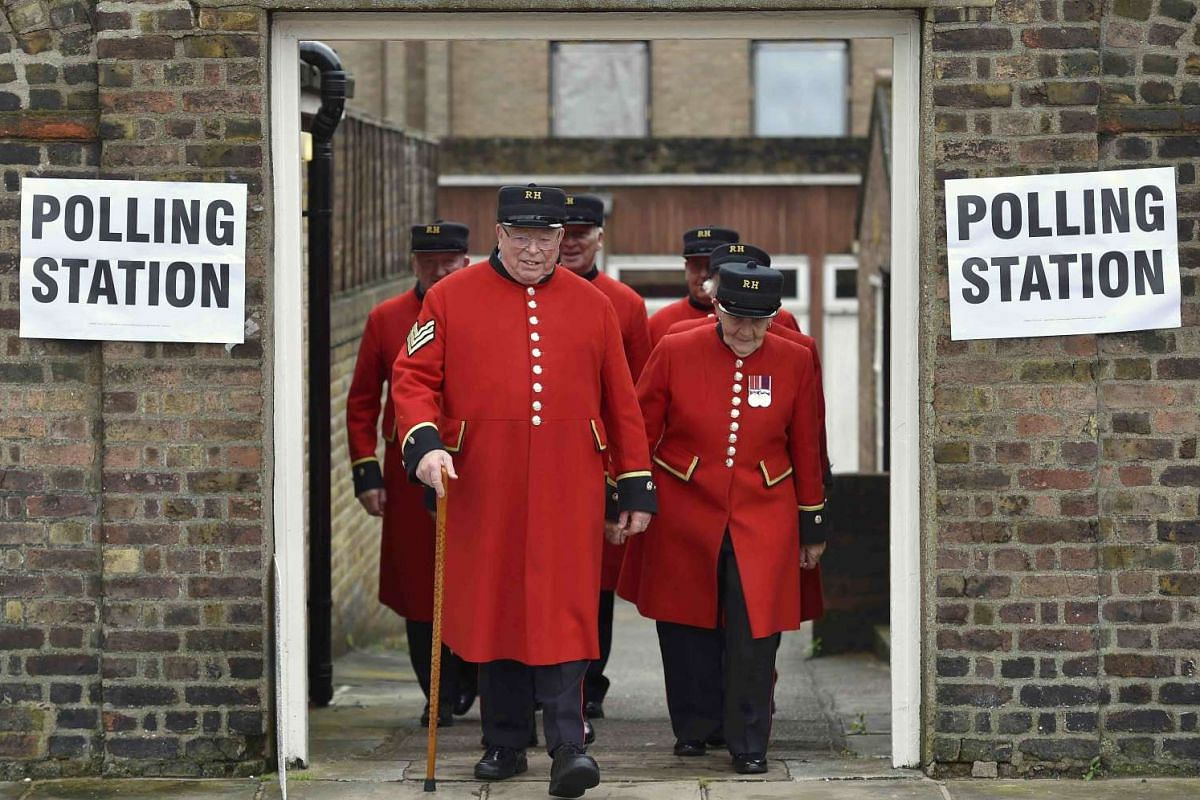 Pensioners leave after voting at a polling station in Chelsea in London on June 23, 2016.