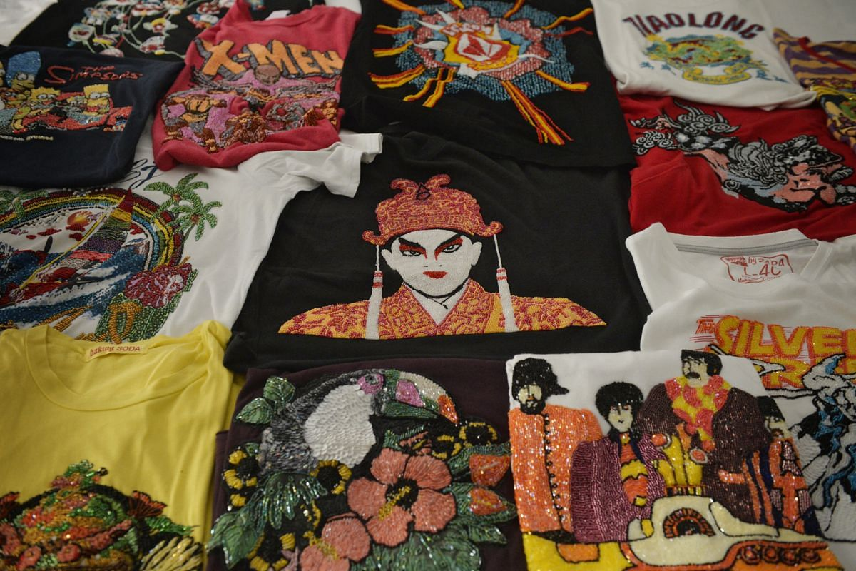 His collection of bespoke beaded T-shirts (above).