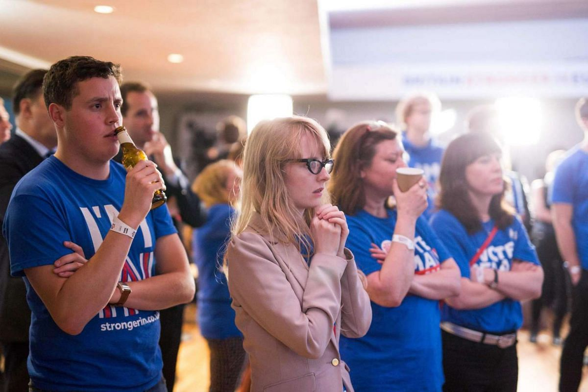 """Supporters of the """"Stronger In"""" Campaign watch the results of the EU referendum being announced at a results party at the Royal Festival Hall in London, Britain, on June 24, 2016."""