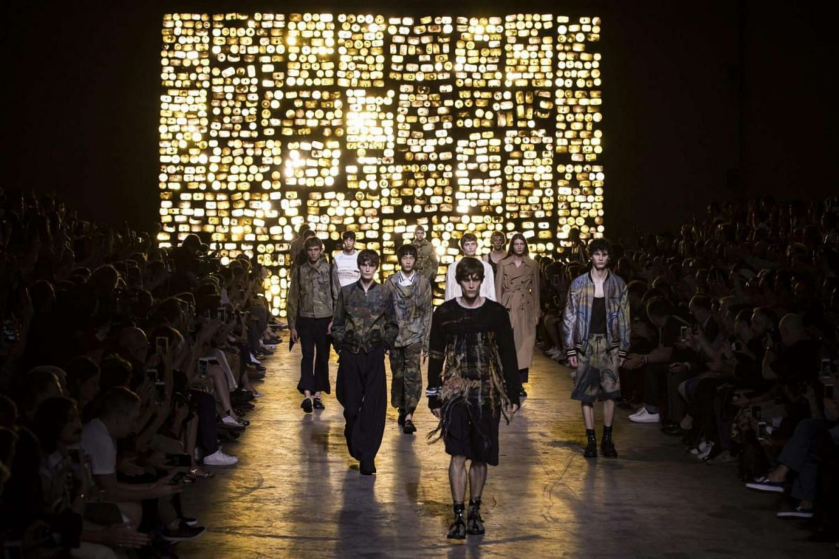 Models present creations from the Spring/Summer 2017 Men's collection by Belgian designer Dries Van Noten during the Paris Fashion Week, in Paris, France, on June 23, 2016. The presentation of the Men's collections runs from June 22 to 26.