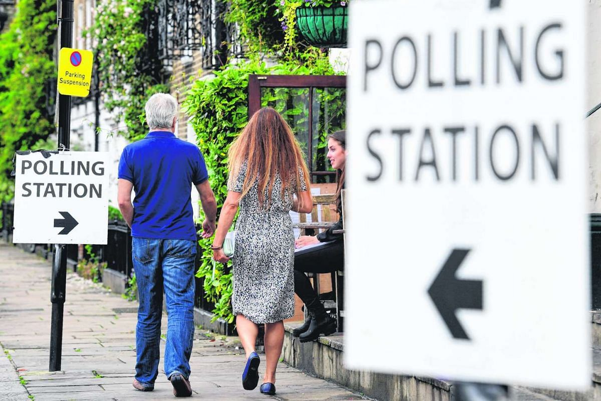 People arrive to vote at a polling station set up at the Anglesea Arms pub in London, on June 23, 2016.