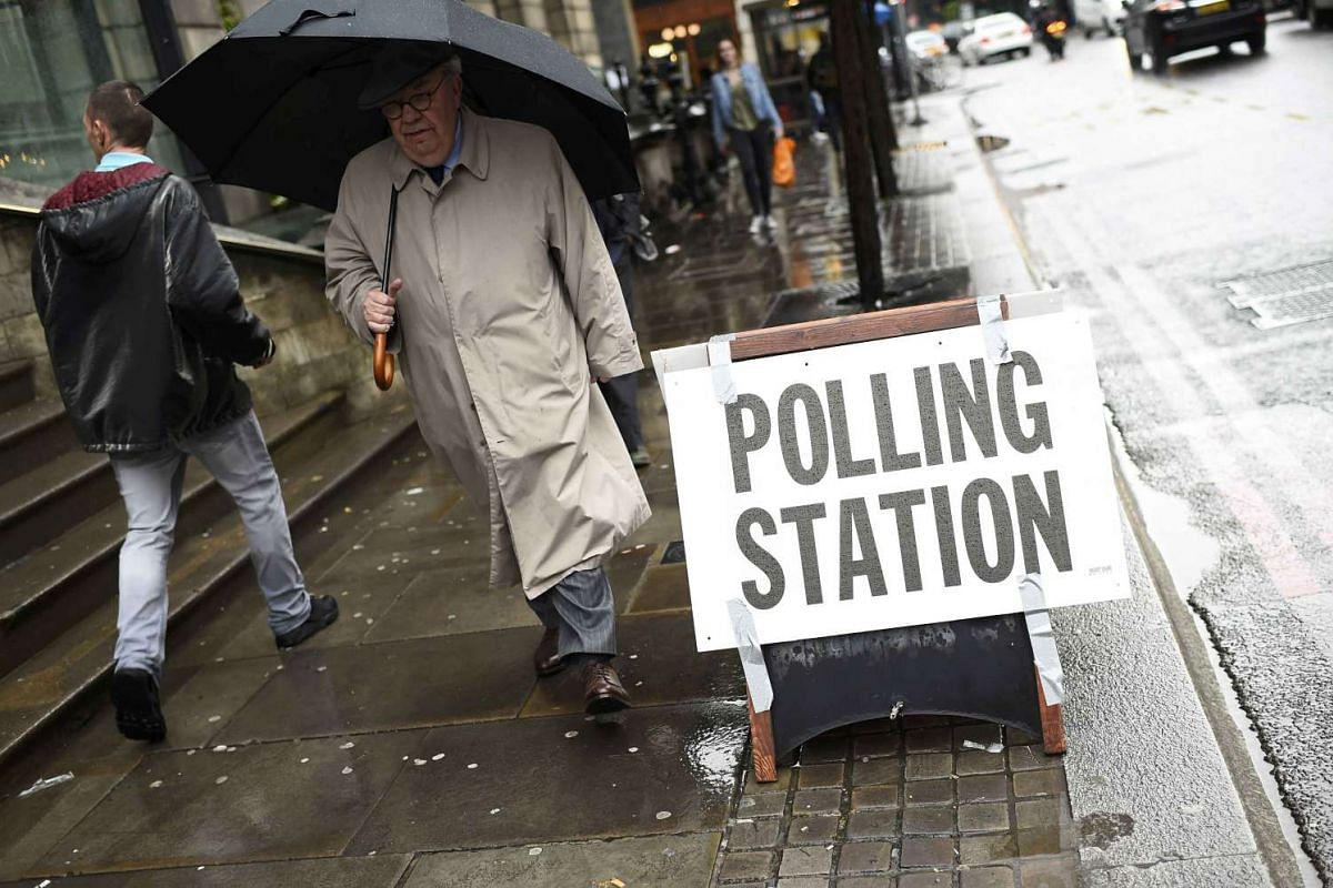 A man passes a polling station on the day of the EU referendum in central London, Britain June 23, 2016.
