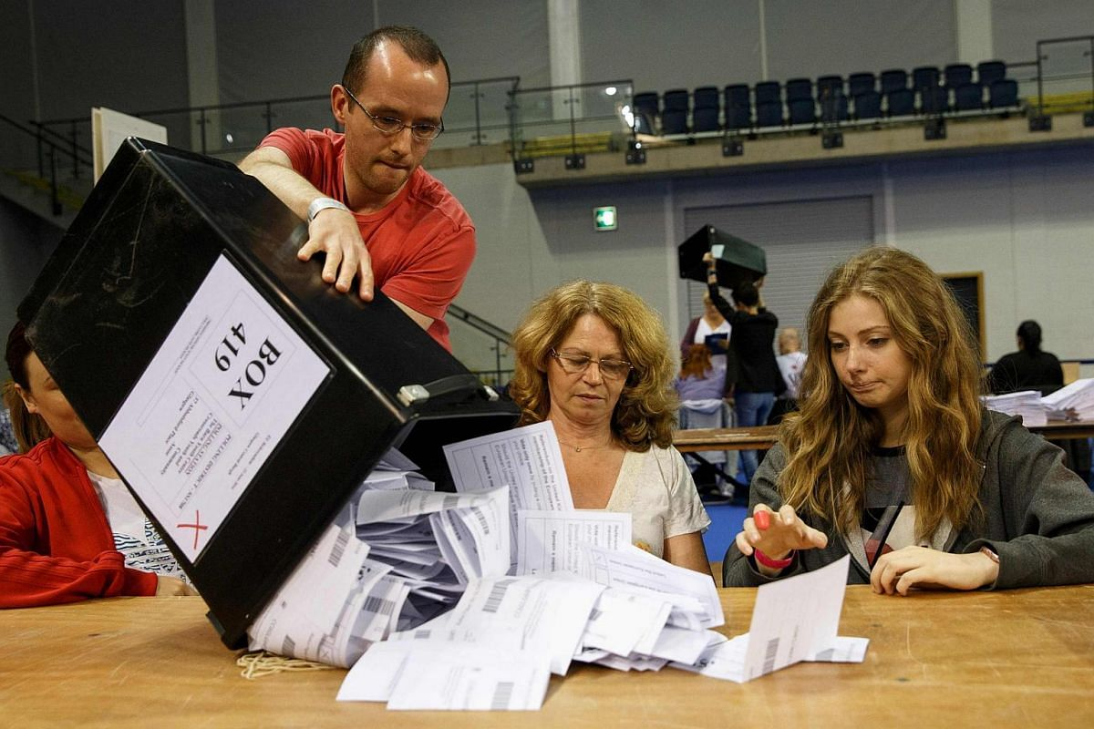 Staff count ballot papers at the Glasgow count centre at the Emirates Arena, Glasgow, Scotland, on June 23.