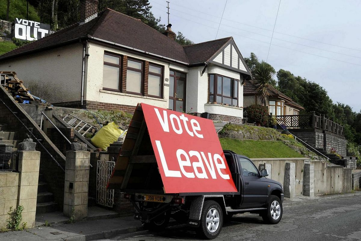 A sign is displayed opposite the M4 near Tata Steel works, on the day of the EU referendum, in Port Talbot in Wales on June 23, 2016.