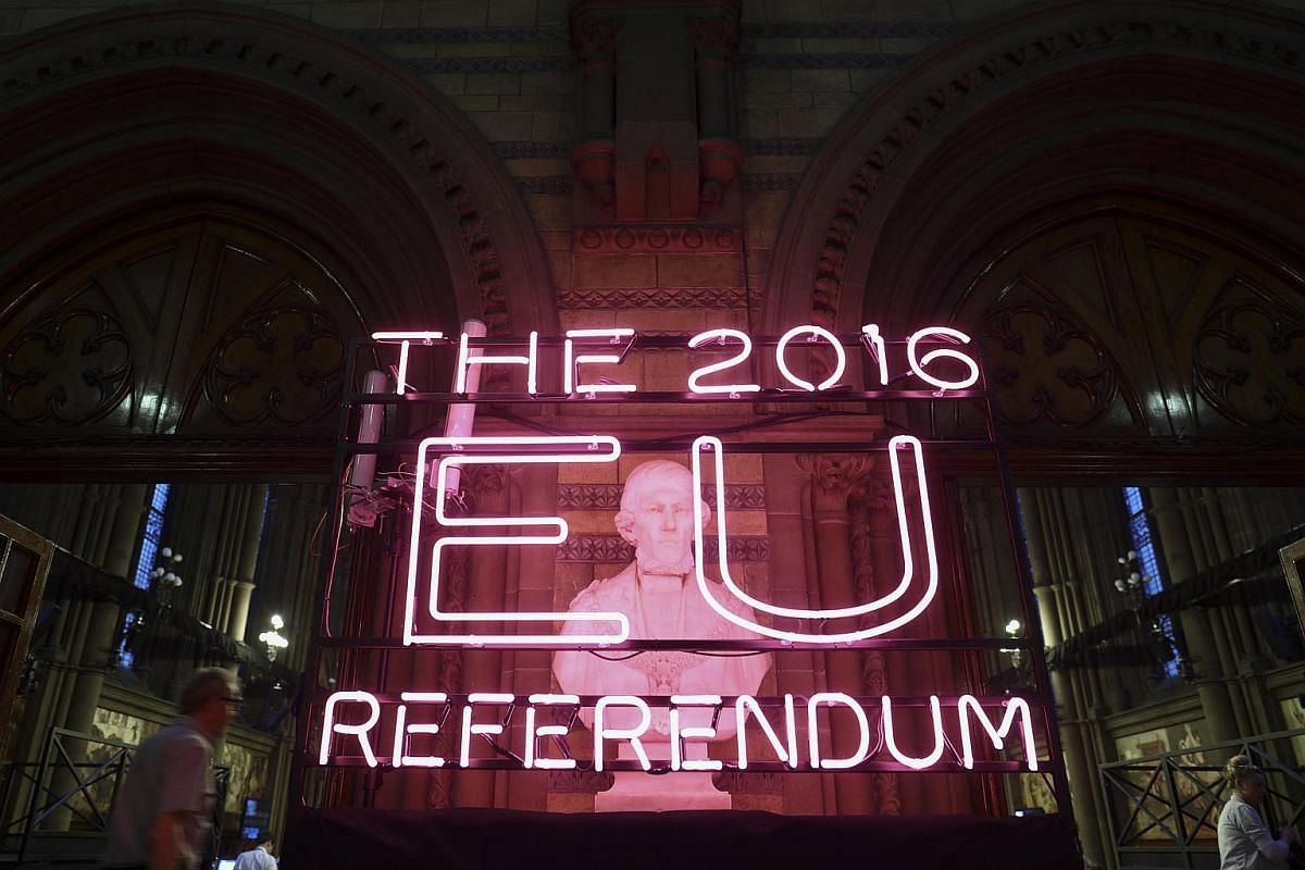 A European Union (EU) referendum neon sign sits at Manchester Town Hall in Manchester on June 23.