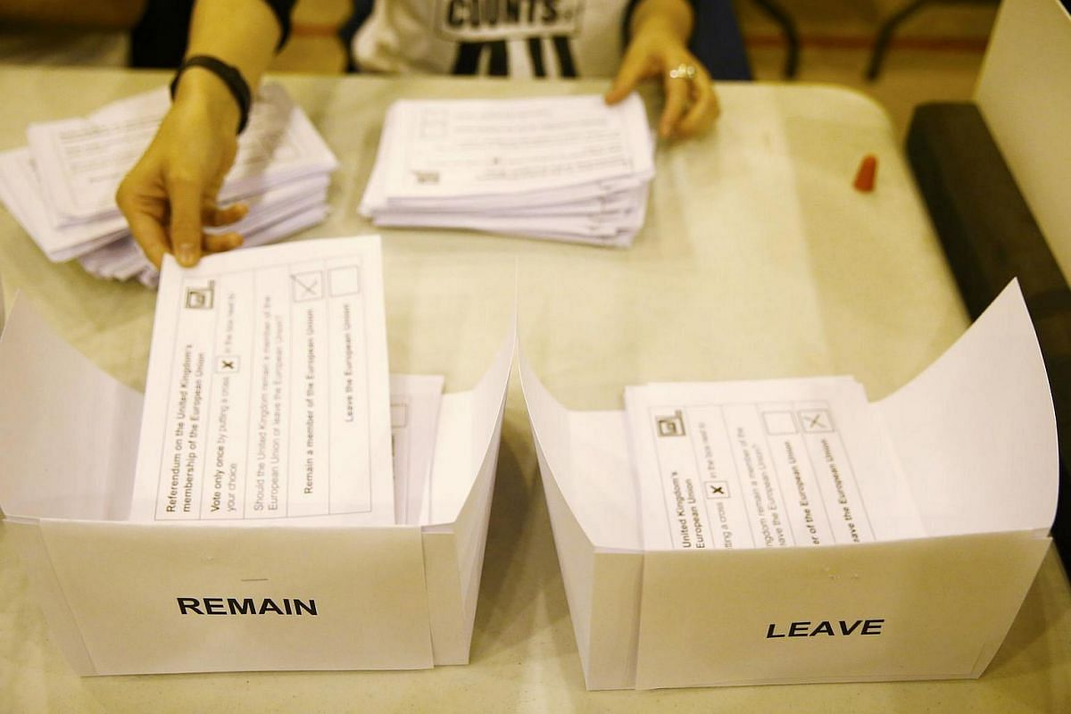 A workers counts ballots after polling stations closed in Islington, London, on June 23.