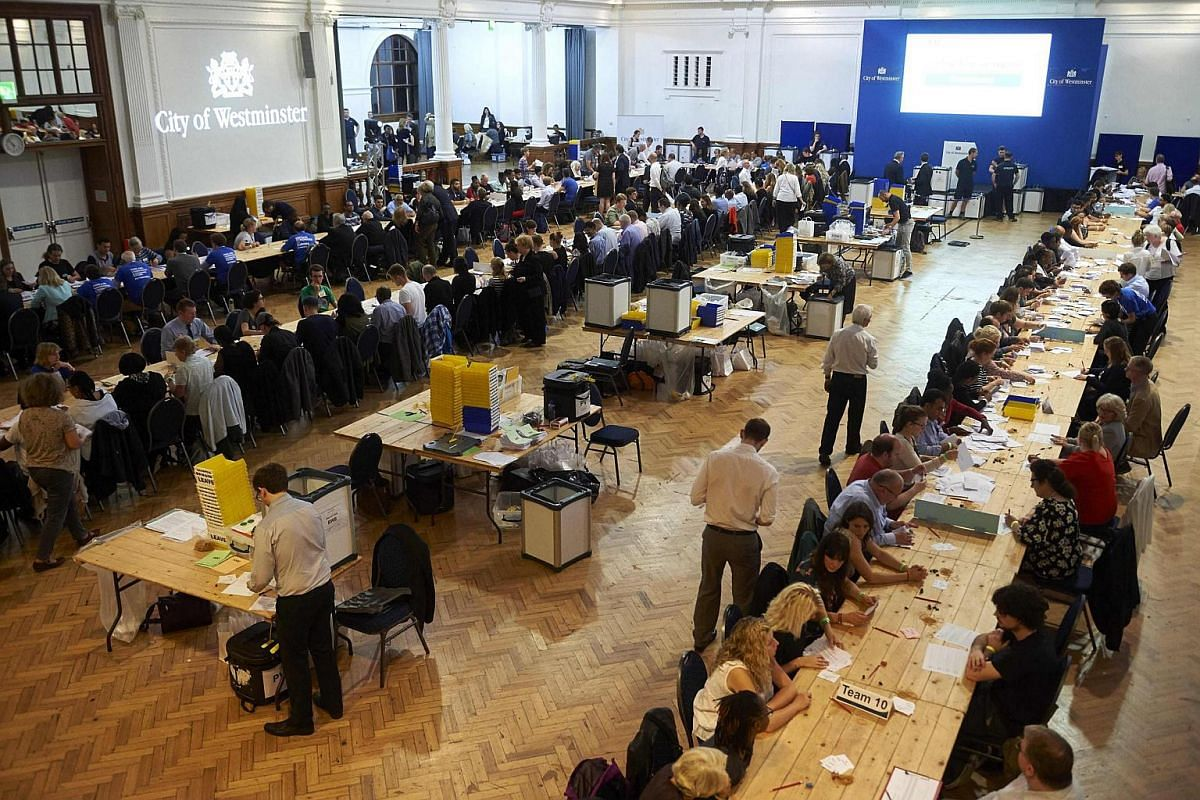 Vote-counting staff sort ballot papers at a counting centre at The Royal Horticultural Halls in central London on June 23.