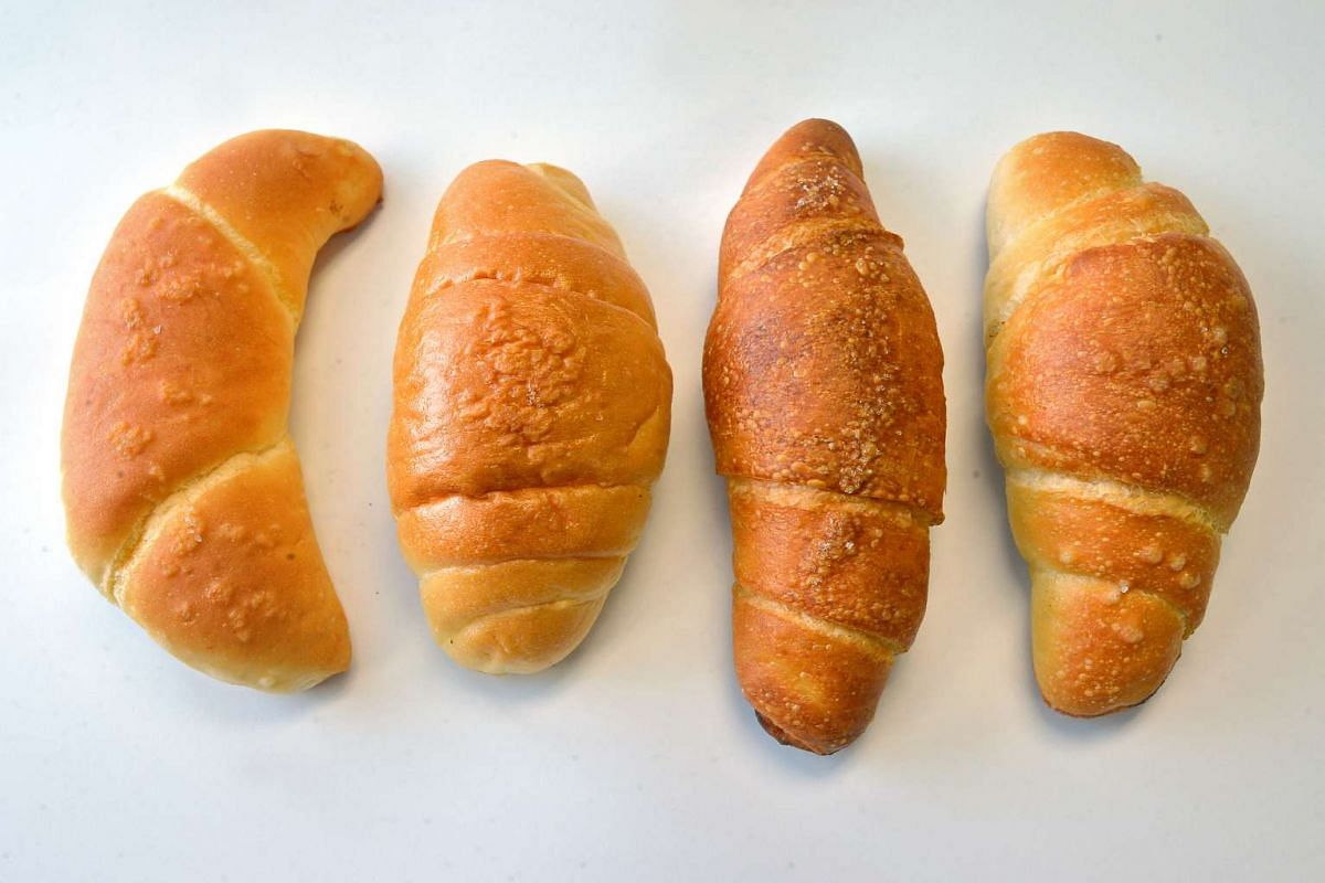 From far left, shio pan, or salt bread, from bakeries St. Leaven, BreadTalk, Johan Paris and Donq.