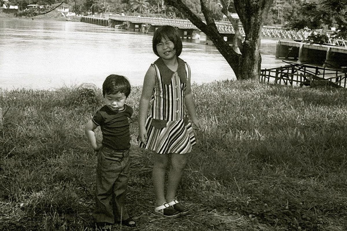 Author Tash Aw with his older sister on the banks of a river in Parit, a town in Perak. He often spent school holidays there at his maternal grandfather's house.
