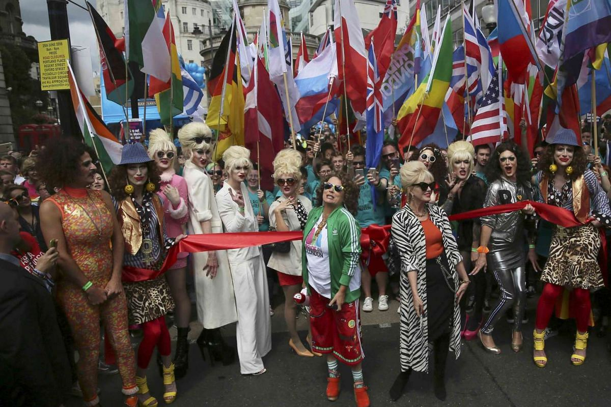 """Actresses Jennifer Saunders (front left) and Joanna Lumley (front right) promote their film """"Absolutely Fabulous"""", at the start of the annual Pride London Parade on June 25, 2016."""