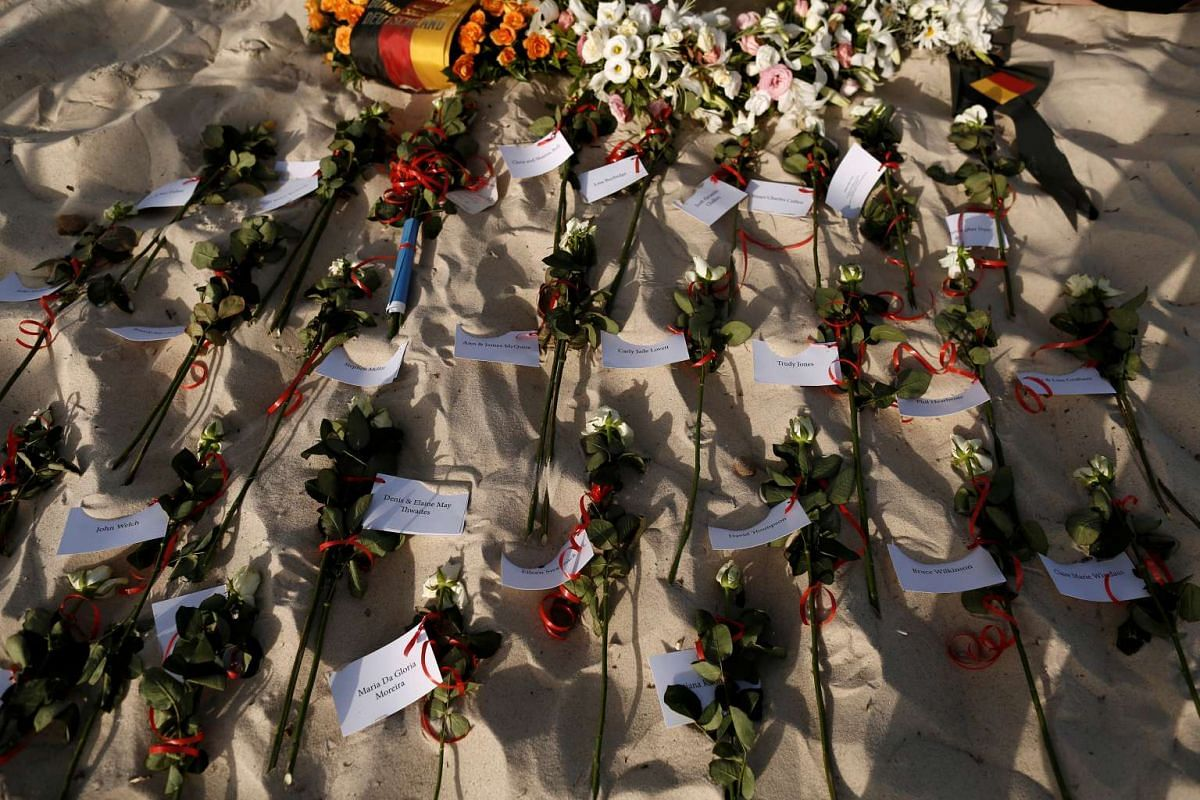 Flowers bearing tags with names of victims of an attack by a gunman at the hotel in Sousse, Tunisia during the first anniversary of the incident on June 26, 2016.