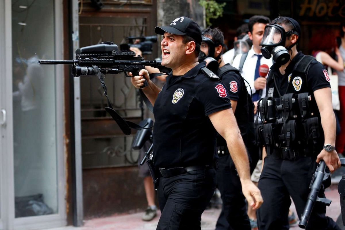 Riot police use rubber pellets to disperse LGBT rights activists as they try to gather for a pride parade in Istanbul, Turkey on June 26, 2016.