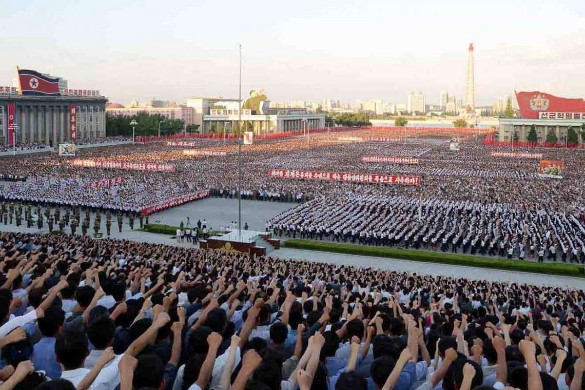 """Thousands of Pyongyang residents attending a """"6.25 anti-US day"""" rally at Kim Il-Sung Square in Pyongyang on June 25, 2016."""