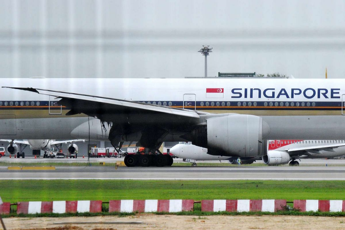 A Singapore Airlines Boeing 777 plane on the runway of Changi Airport Terminal 2 which caught fire on June 27, 2016.