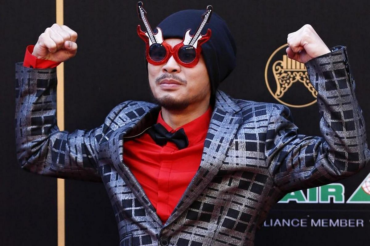 Malaysia's Wee Meng Chee decides to jazz up his dapper red shirt and bow tie with funky guitar sunglasses.