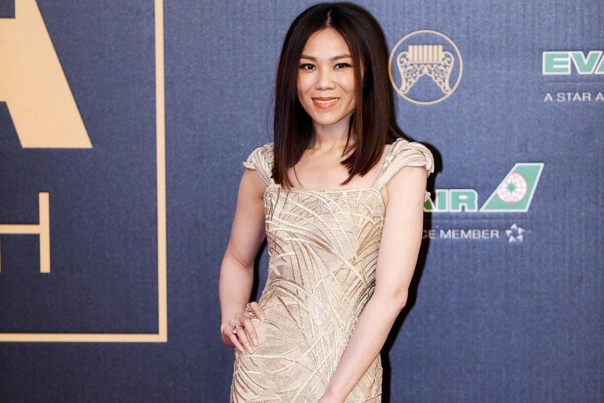 Singapore's Tanya Chua goes for an elegant flash of leg in her floor-length gown.