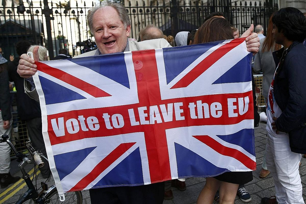 A Leave supporter holding up a flag after the result of the EU referendum outside Downing Street on Friday. A breakdown of results showed those who voted Leave were predominantly from the older generation. There was disbelief etched on many a face at