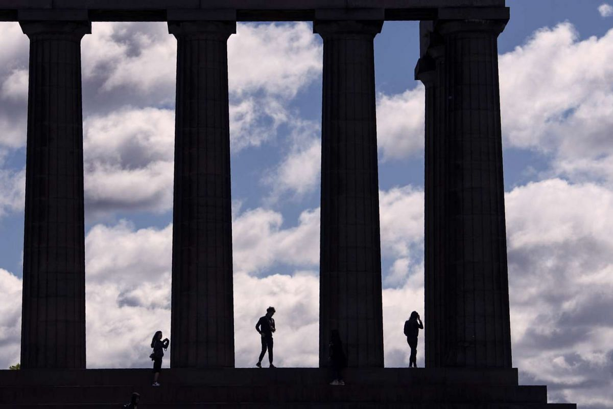 Members of the public stand on the National Monument of Scotland, on Calton Hill in Edinburgh, Scotland, on June 27, 2016.
