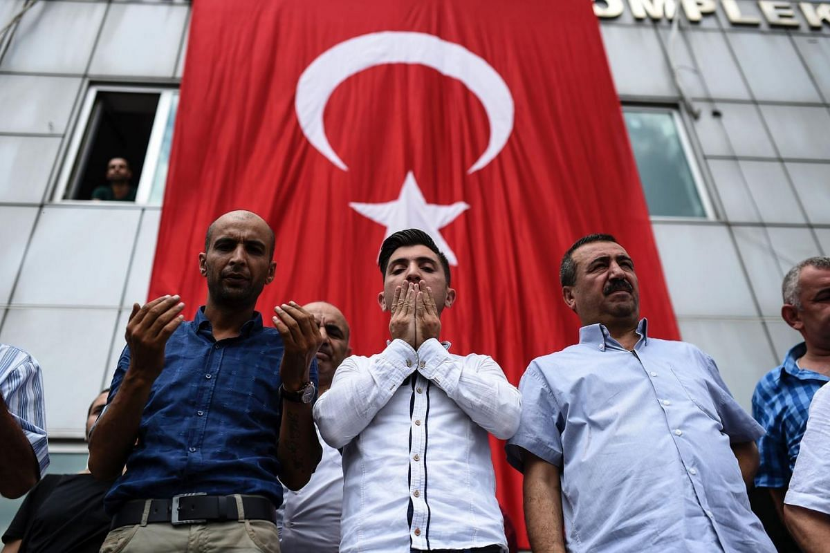 People attend the funeral ceremony of one of the victims of Tuesday's attack on Istanbul's Ataturk international airport. Turkey declared a day of national mourning on June 29, 2016, after the deadly attack, which was blamed by the government on Isla