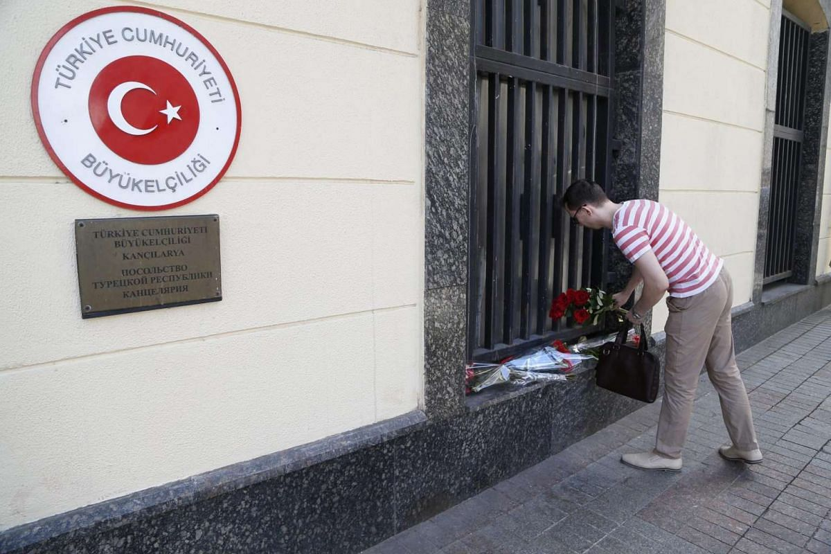 A Russian man pays tribute in front of the Turkey embassy in Moscow, Russia, on June 29, 2016. At least 41 people were killed and more than 230 others were wounded in attacks at the Ataturk international airport in Istanbul on Tuesday.