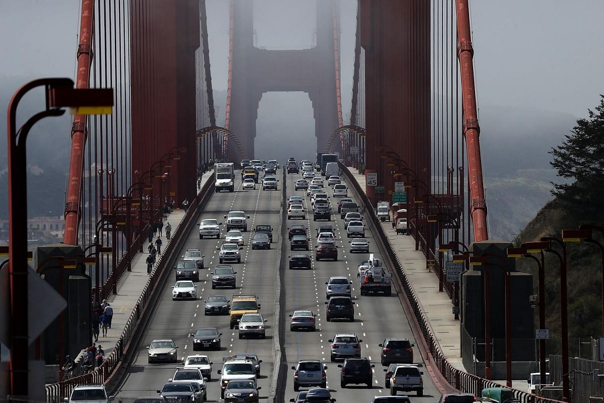 Cars drive over the Golden Gate Bridge on June 28, 2016 in Sausalito, California.