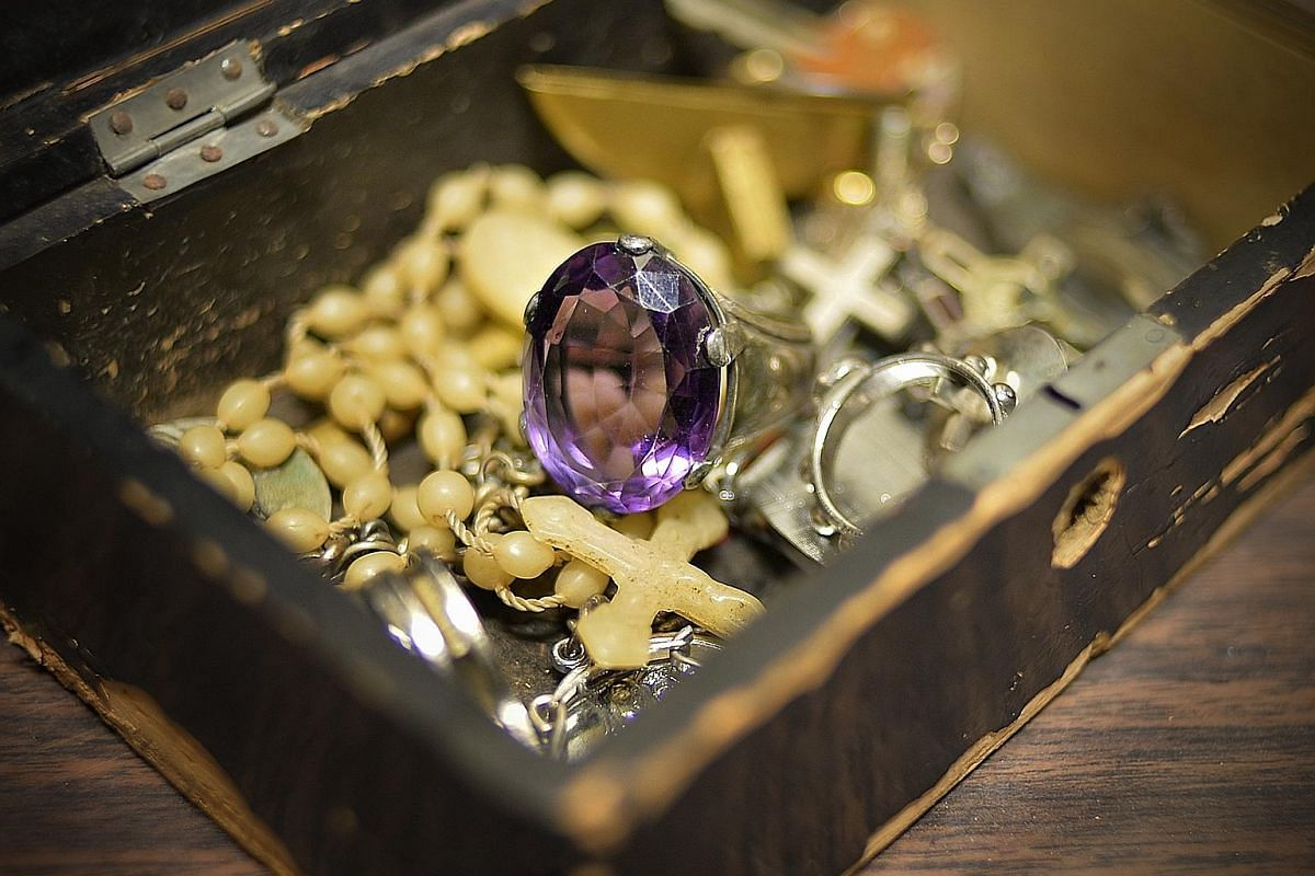 The pontifical ring of the Most Reverend Michel Olcomendy, the first archbishop of Singapore. The ring, set with a large amethyst, is larger than usual as it was meant to be worn over gloves when the bishop celebrated a Pontifical High Mass. A silver