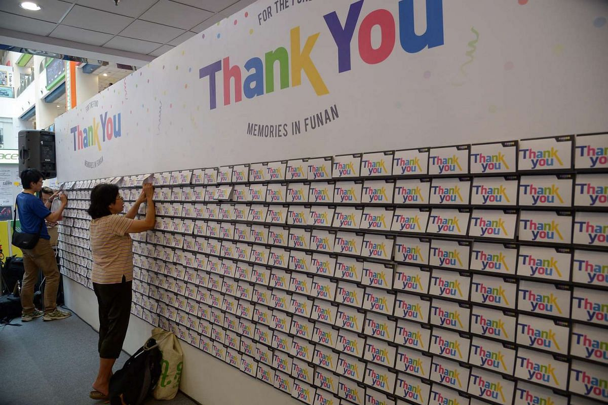 Shoppers penning messages on the 'Thank you for the fond memories in Funan' wall on June 26, 2016.