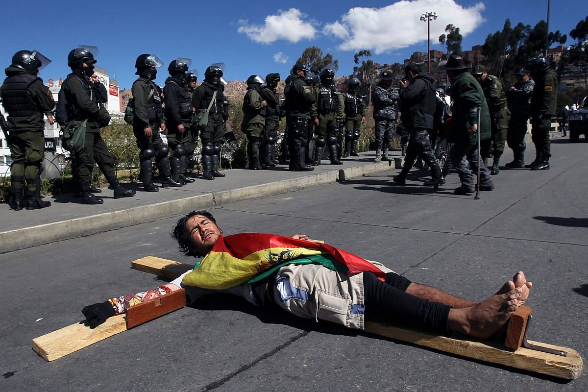 Unionised workers of the Bolivian Worker's Central protest by blocking the freeway connecting La Paz with El Alto in Boliva, on June 29, 2016.