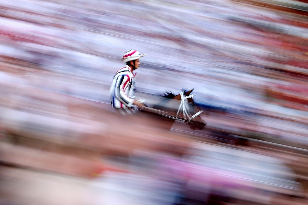"""Jockey Elias Mannucci of """"Istrice"""" (Porcupine) parish rides his horse during the first practice for the Palio horse race in Siena, Italy on June 29, 2016."""