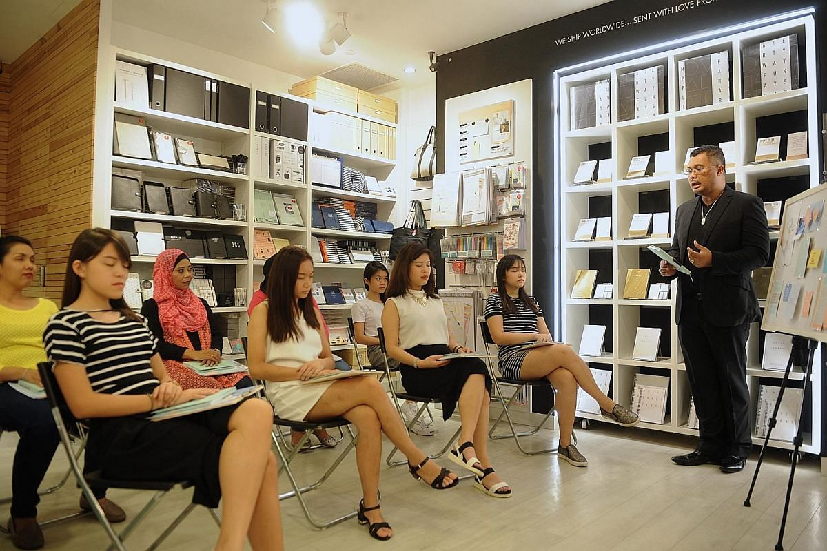 Ms Silvia Wetherell (on a green cushion) and Ms Joanna Bush (in beige cardigan) at a Mindful Mums workshop (right). Mr Shahrul Hussin leading a mindfulness workshop at kikki.K stationery shop. Mr Thomas Heng leading a meditation session at the Botani