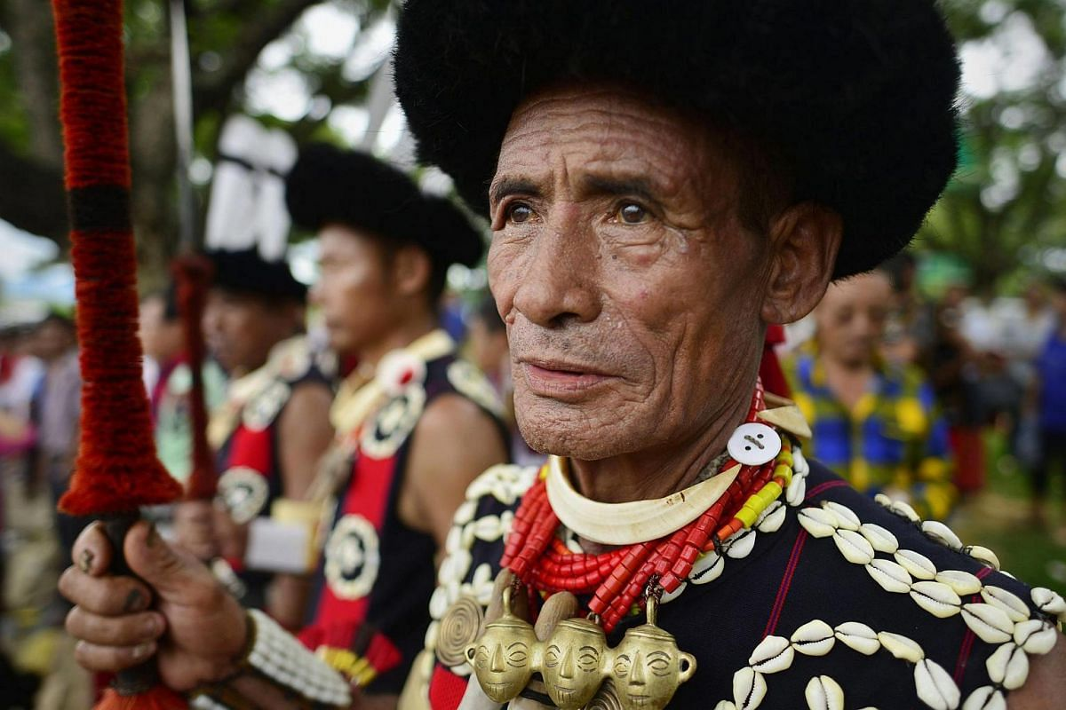 Naga tribesmen wait to receive the mortal remains of the Chairman of the National Socialist Council of Nagalim (Isak-Muivah) Isak Chisi Swu at Dimapur airport in Nagaland, India, on June 30.