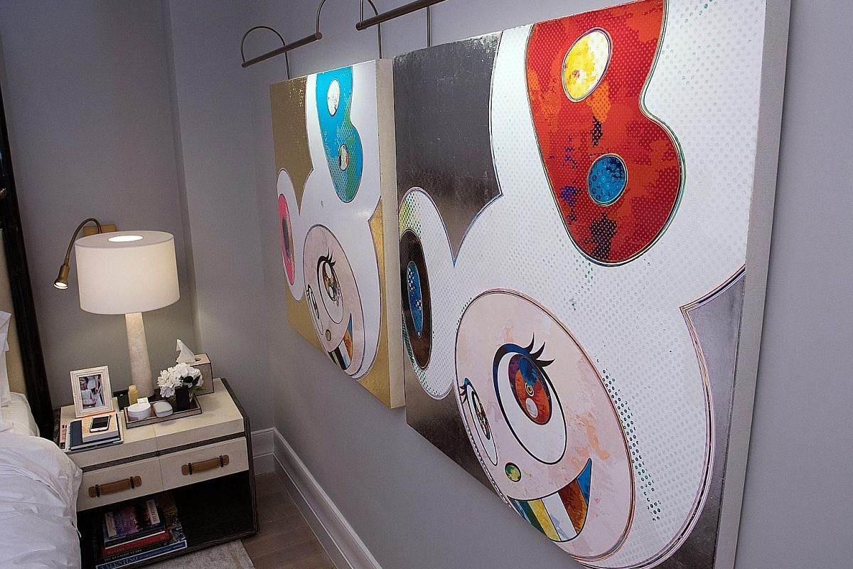 Photographs by American pop artist Andy Warhol dot a hallway in the New York home of Singaporean Cindy Chua-Tay (left), while Japanese artist Takashi Murakami's DOB in gold and silver (2012) hangs in the master bedroom (below). (Above) A Ceccotti Col