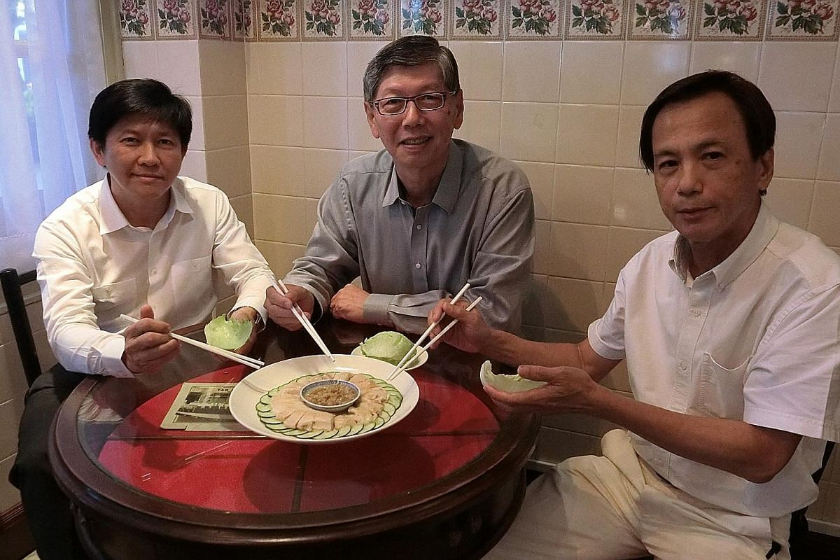 My Life So Far: Soup Restaurant's co-founders - (from left) Mr Wong Chi Keong, Mr Wong and Mr Mok Yip Peng - with the eatery's signature dish, samsui ginger chicken, at the newest outlet in Raffles Hotel.