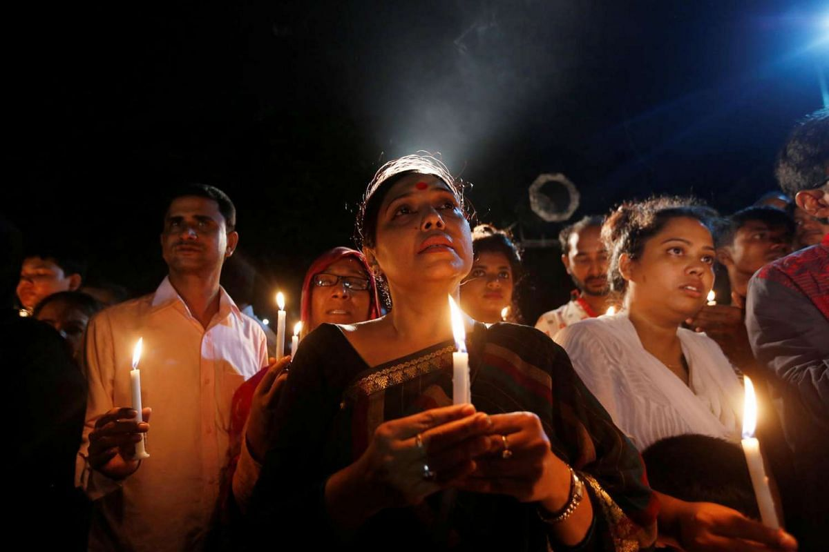 People attend a candle light vigil for the victims of the attack on the Holey Artisan Bakery and the O'Kitchen Restaurant, in Dhaka, Bangladesh on July 3, 2016.
