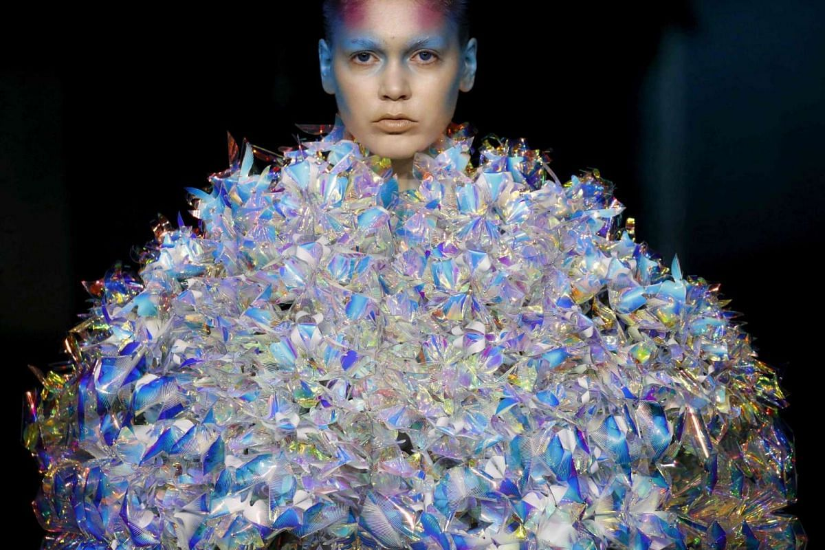 A model presents a creation by Yuima Nakazato during the 2016-2017 fall/winter Haute Couture collection fashion show on July 3, 2016 in Paris.
