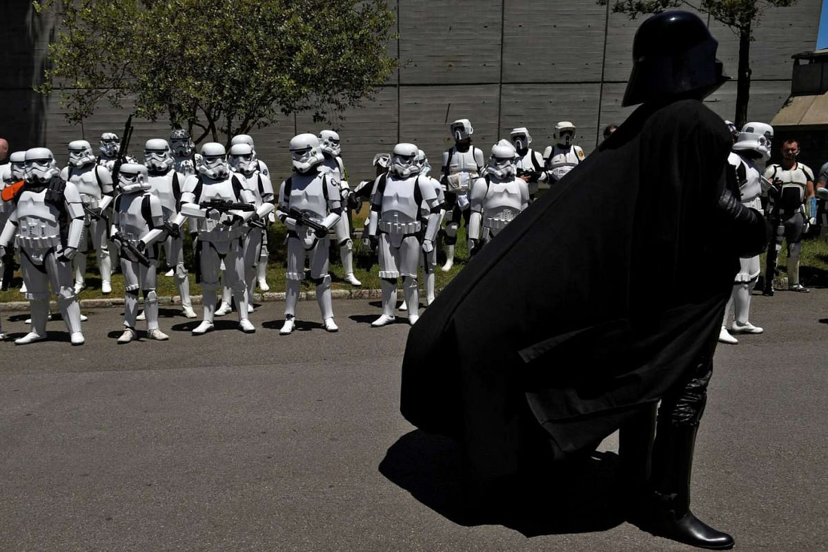 People wearing Star Wars costumes are seen during the parade in Metropoli (Media Culture and Entertainment Festival) in Gijon, northern Spain on July 3, 2016.