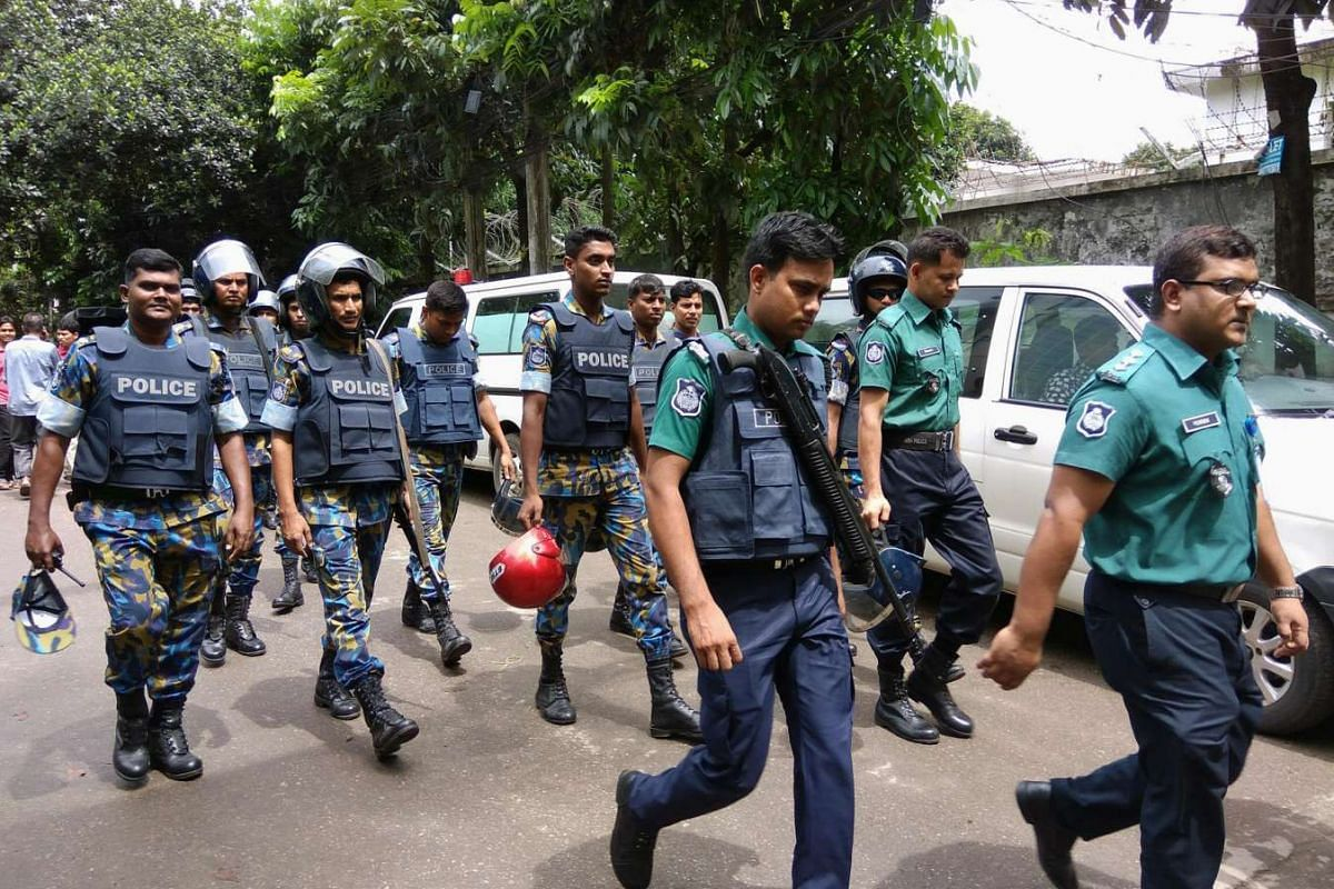 Security personnel are seen near the Holey Artisan restaurant in Dhaka, Bangladesh, on July 2.