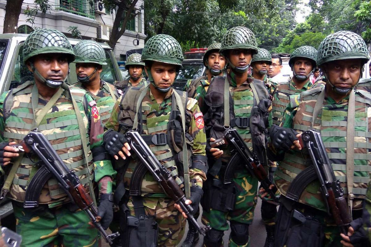 Army soldiers gather near the Holey Artisan restaurant in Dhaka, Bangladesh, on July 2.