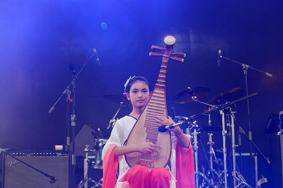 Opera Estate primary school student Zhou Jie Lin playing the Chinese instrument Pipa.