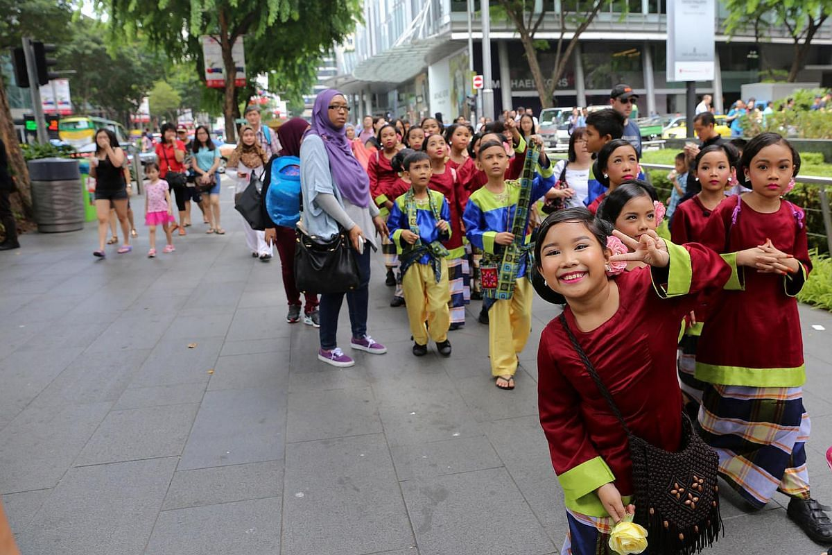 Malay dance performers from First Toa Payoh primary school making their way from *SCAPE to Ion Orchard for the finals of Youth Got Talent!.