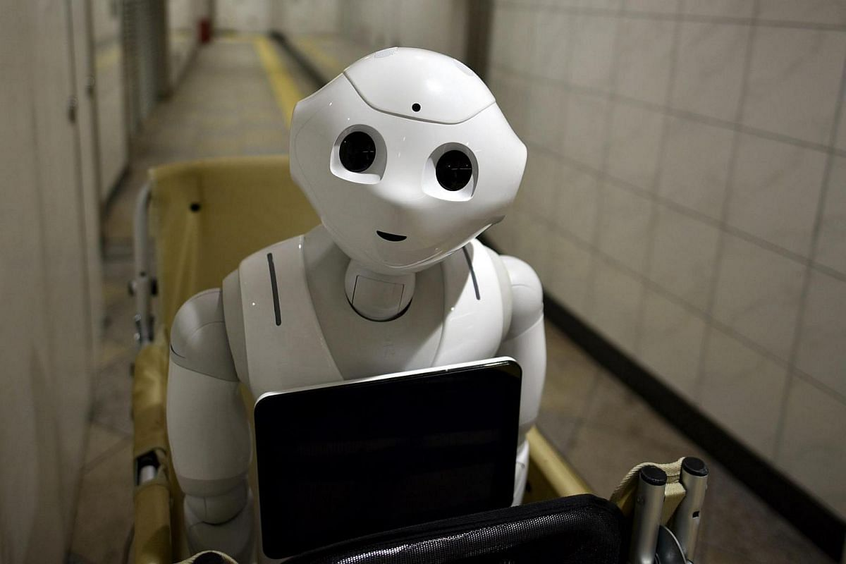 Humanoid robot Pepper in a subway station in Tokyo, Japan, on June 27.