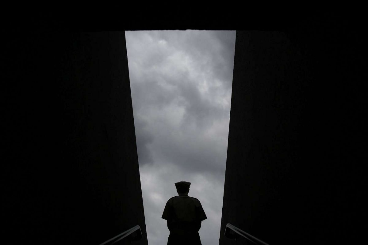A steward keeps watch on an entrance to No. 1 court on the eighth day of the 2016 Wimbledon Championships at The All England Lawn Tennis Club in Wimbledon, on July 4, 2016.