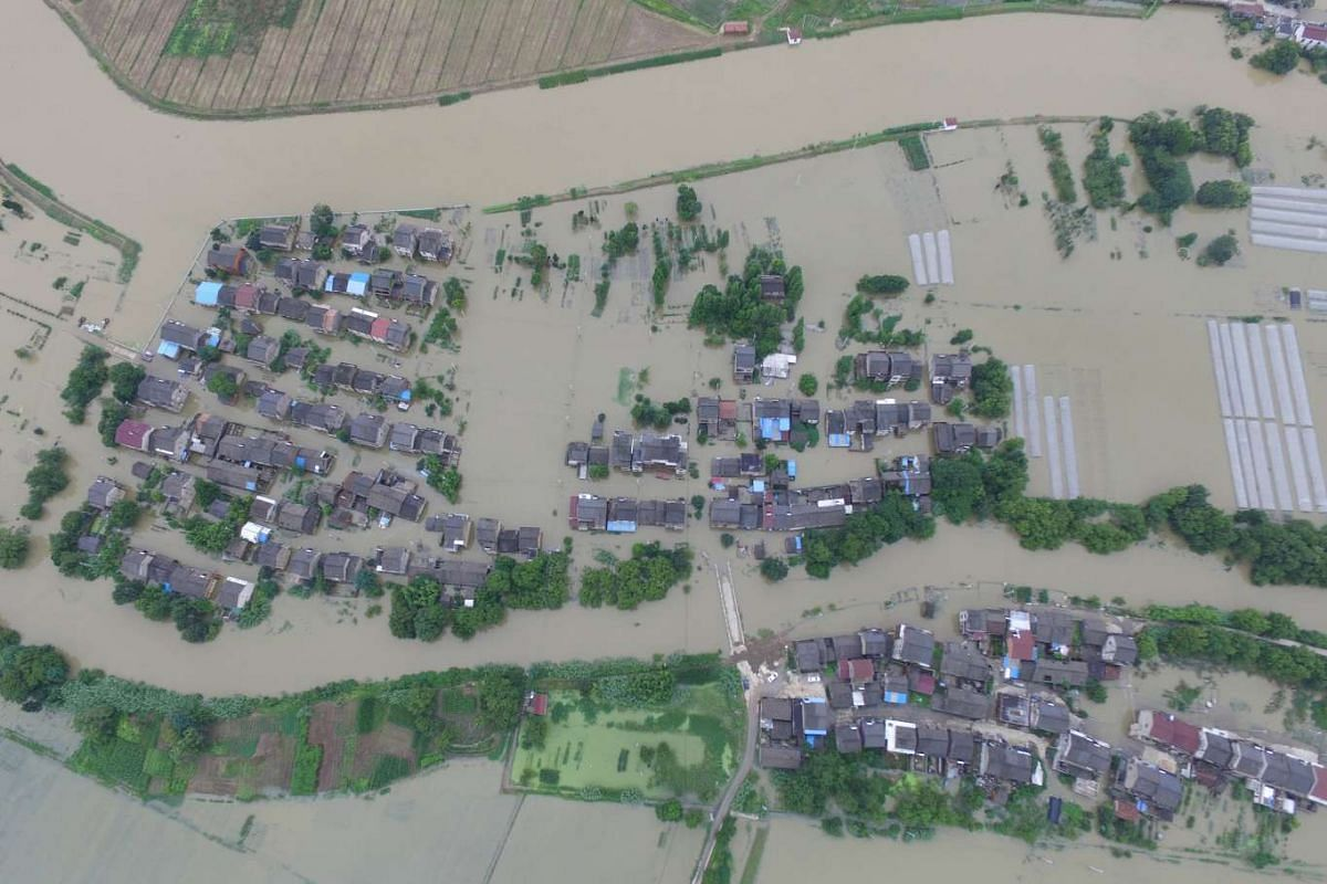 An aerial view shows flooded houses in villages in Wuxi, Jiangsu province, China, on July 4, 2016.