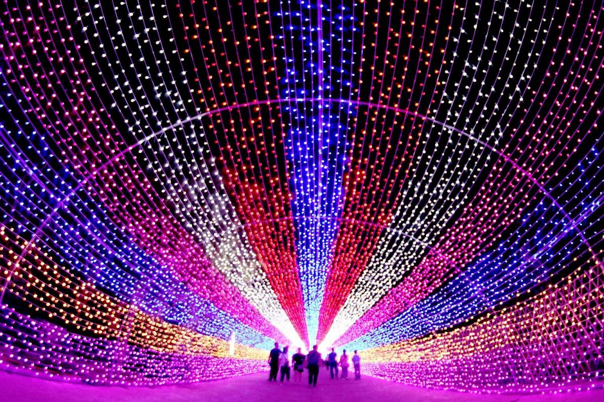 Tourists walk through a lantern installation in Zhangjiakou, Hebei province, China, on July 4, 2016.