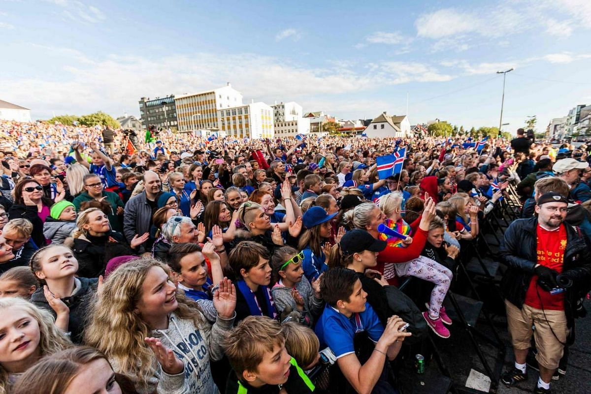 People greet Iceland's national football team upon their arrival in Reykjavik.
