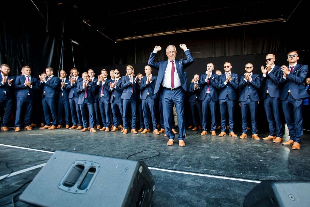 Iceland's coach Lars Lagerback (centre) gestures in front of Iceland's national football team during a welcoming ceremony in Reykjavik.