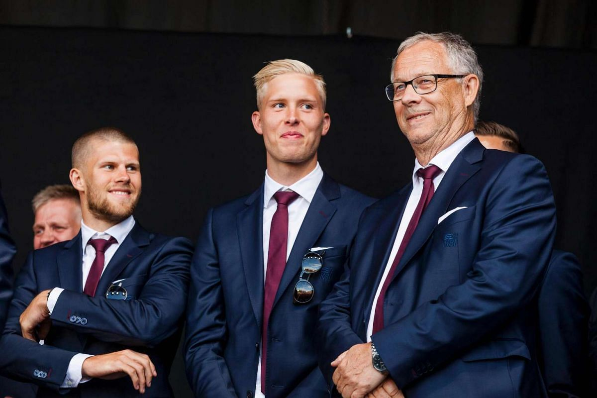 Iceland's coach Heimir Hallgrimsson (right) poses with Icelandic defender Hjortur Hermannsson (left) upon the arrival of the team in Reykjavik.