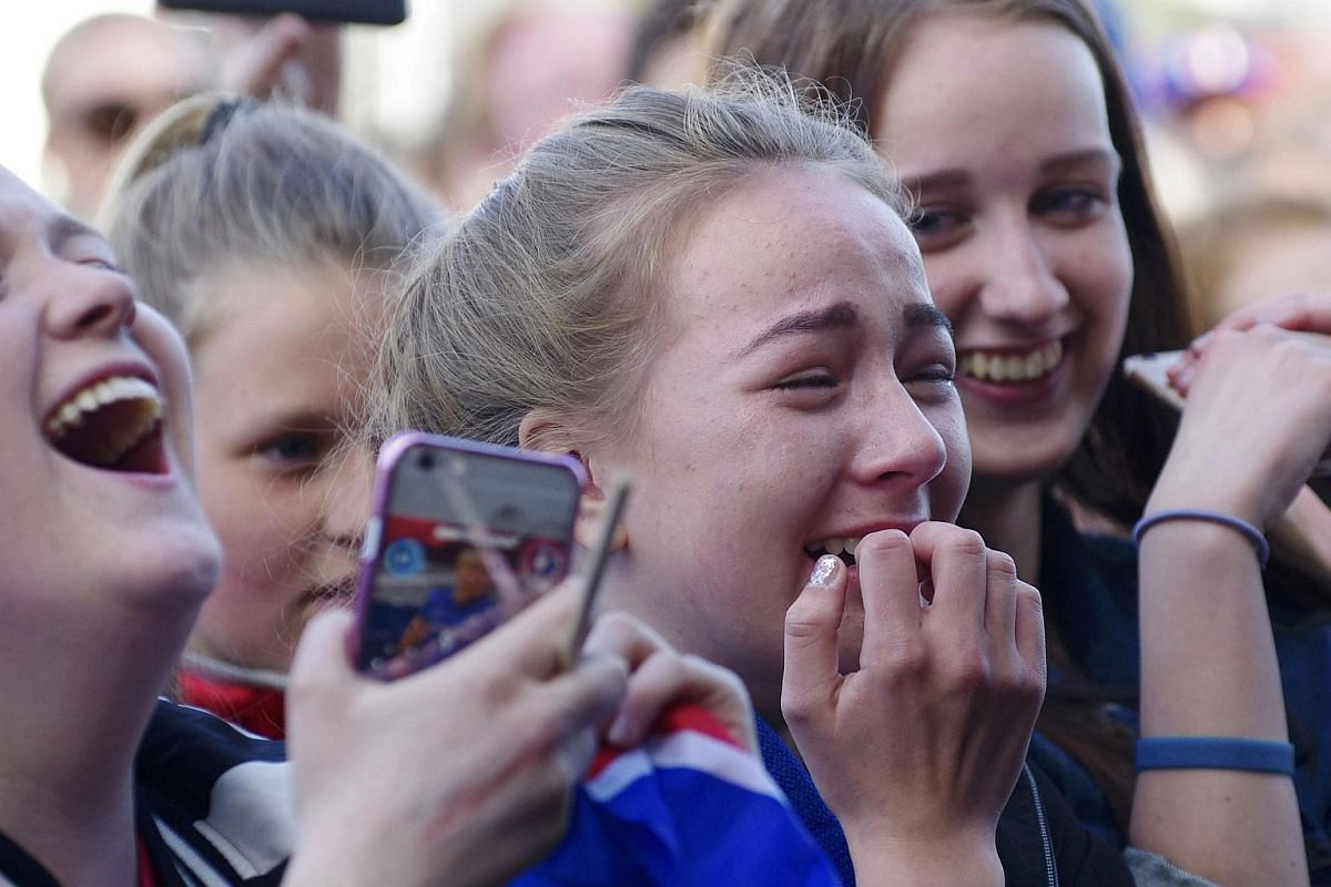 Iceland fans react as they celebrate their team returning home after the Euro 2016 in Reykjavik, Iceland.